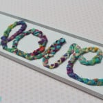 Cute! Make this sign with braided fabric scraps. So easy, too