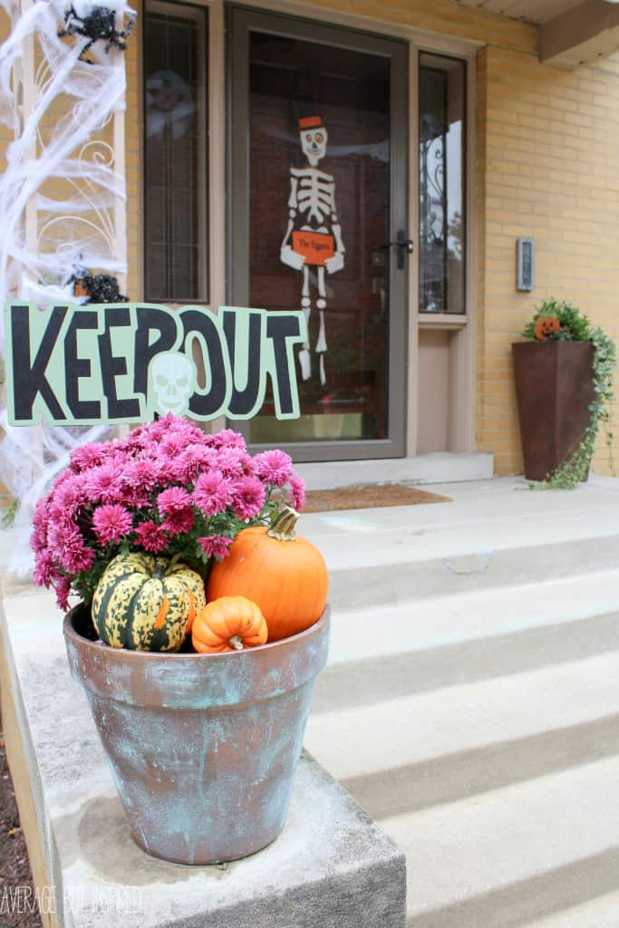 As part of the Fall-oween home tour, Average But Inspired takes you on a tour of her home decked out for fall and Halloween. This simple fall planter gets a scary look with a sign from the dollar store.