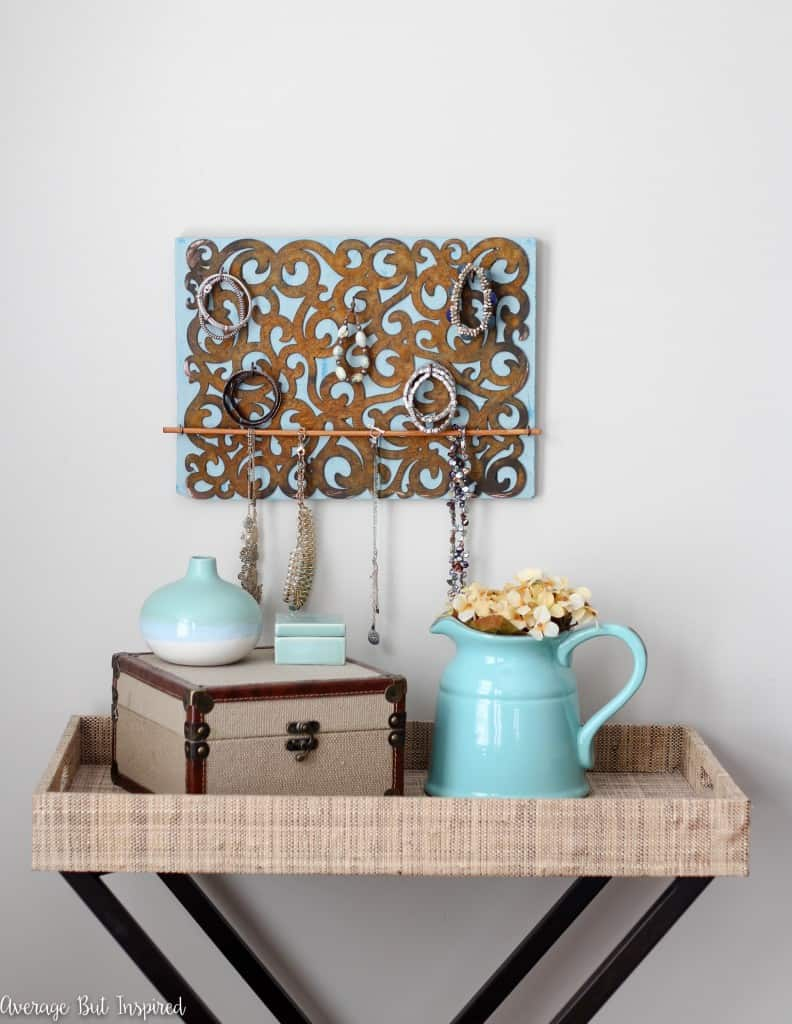 So pretty! Make your own DIY jewelry holder and learn how to give it a faux rust finish with this great tutorial!