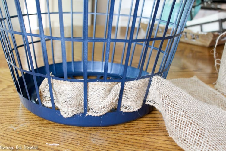It's easy to transform a dollar store laundry basket into a pretty burlap basket! What a great Dollar Tree craft project!